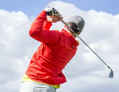 A golfer taking a swing