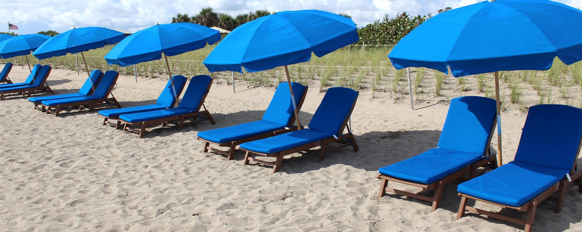 Beach umbrellas and chairs on Jensen Beach that are available for rental.