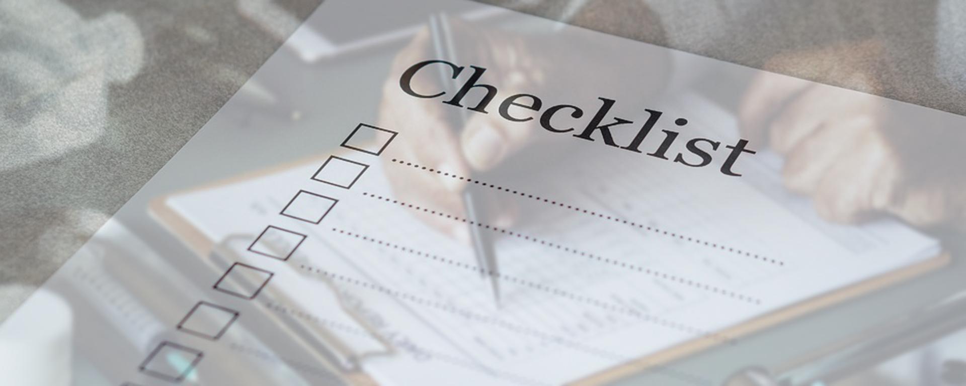 Man reviewing a checklist
