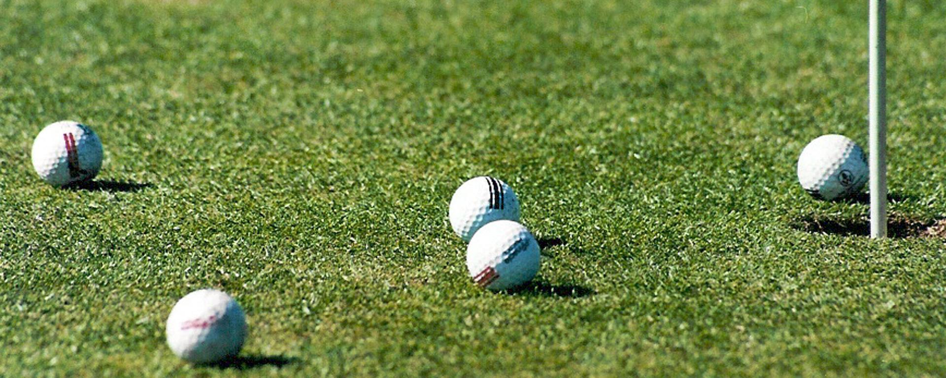 Golf balls on a putting green