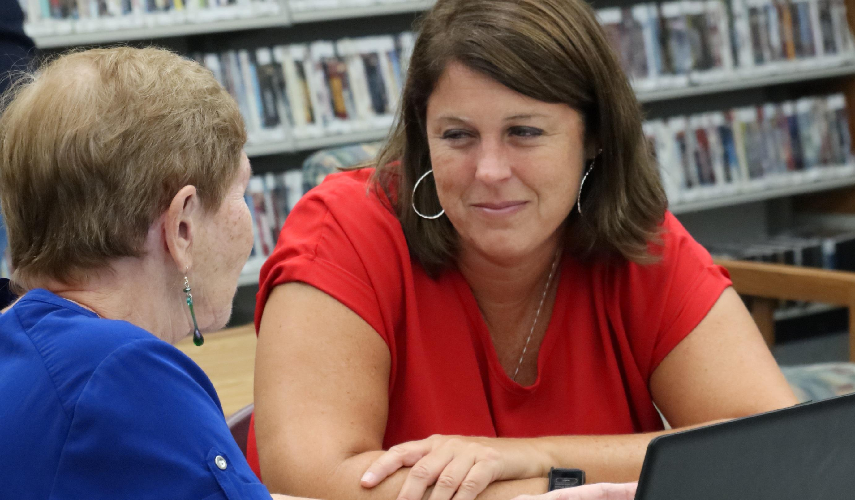 Picture of two adults collaborating at the Hobe Sound Library