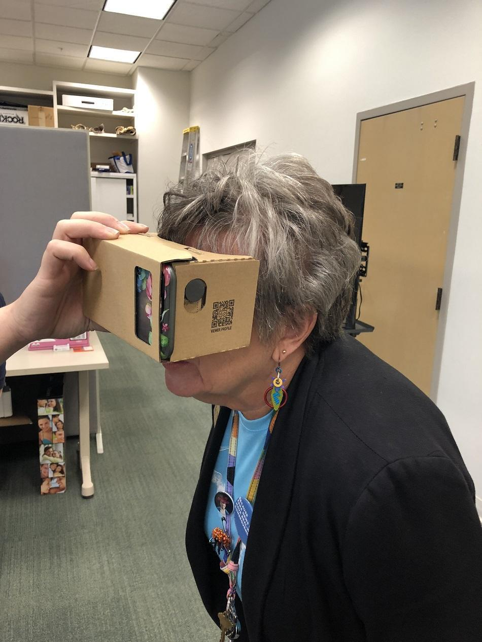 picture of woman using virtual reality goggles