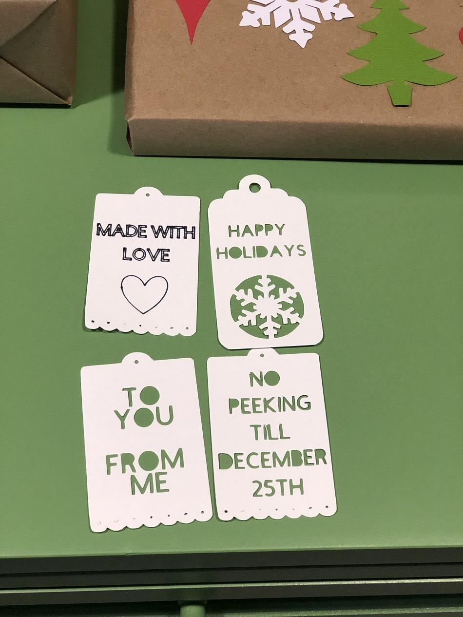 picture of gift tags with intricate designs and cutouts