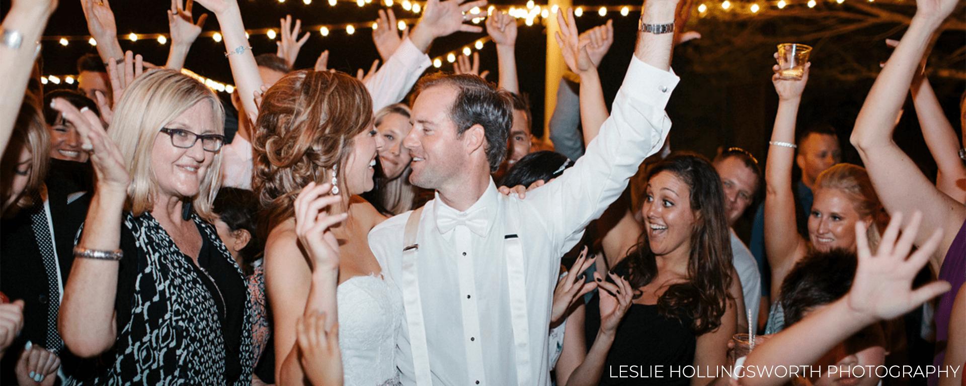 Wedding attendees dancing on the dance floor