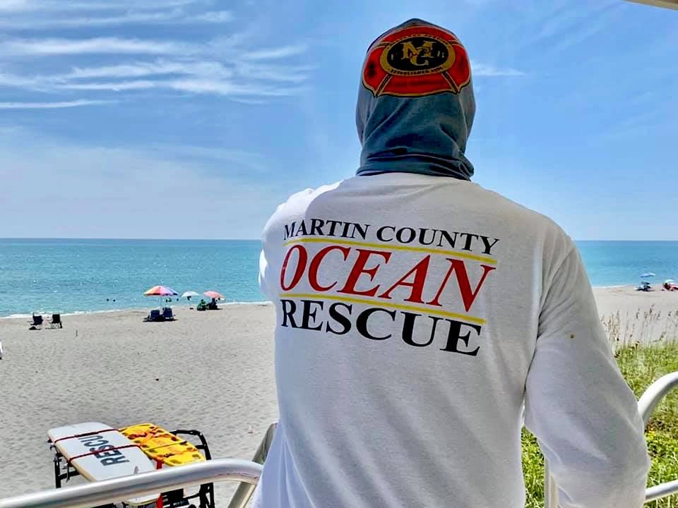 A Martin County lifeguard watching the shoreline