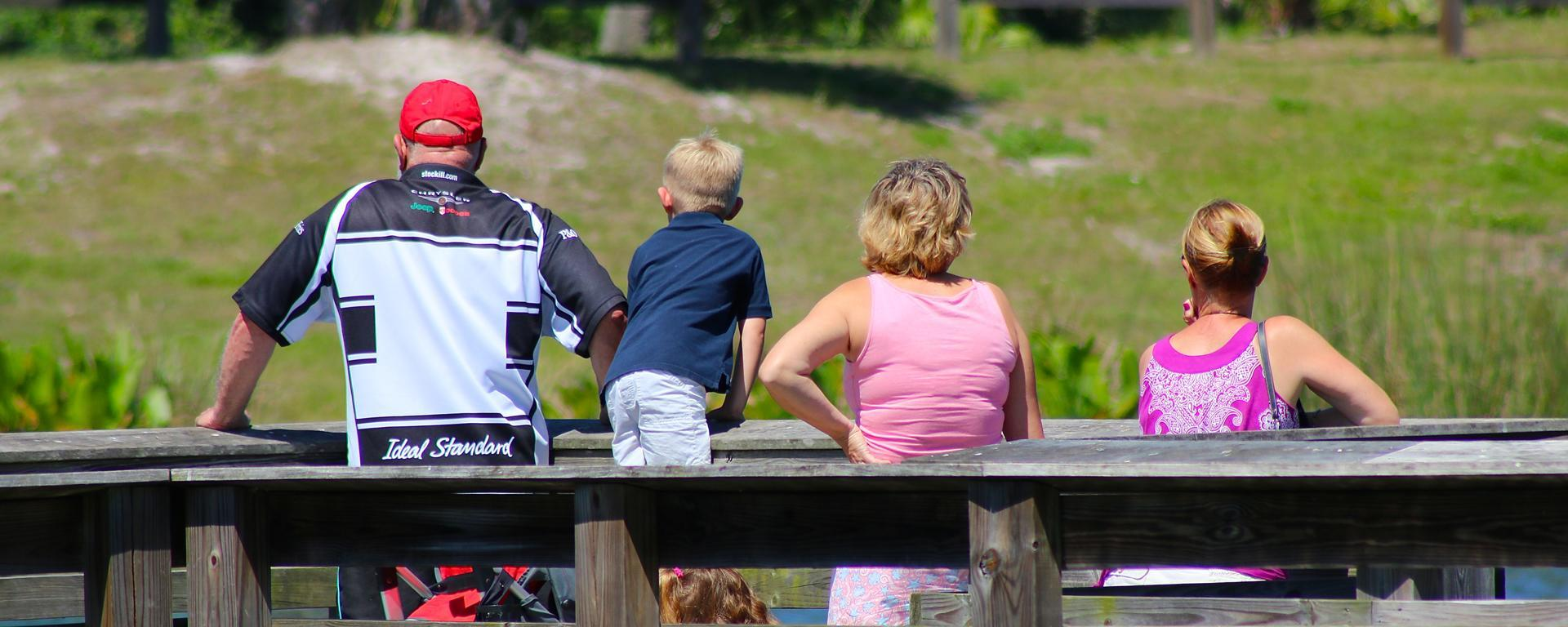 A family overlooking the water at Phipps Park Campground