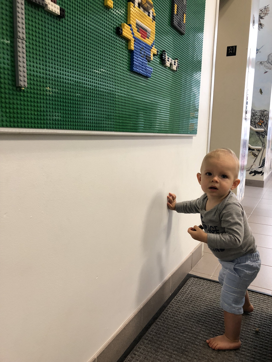 picture of baby boy reaching for LEGO wall