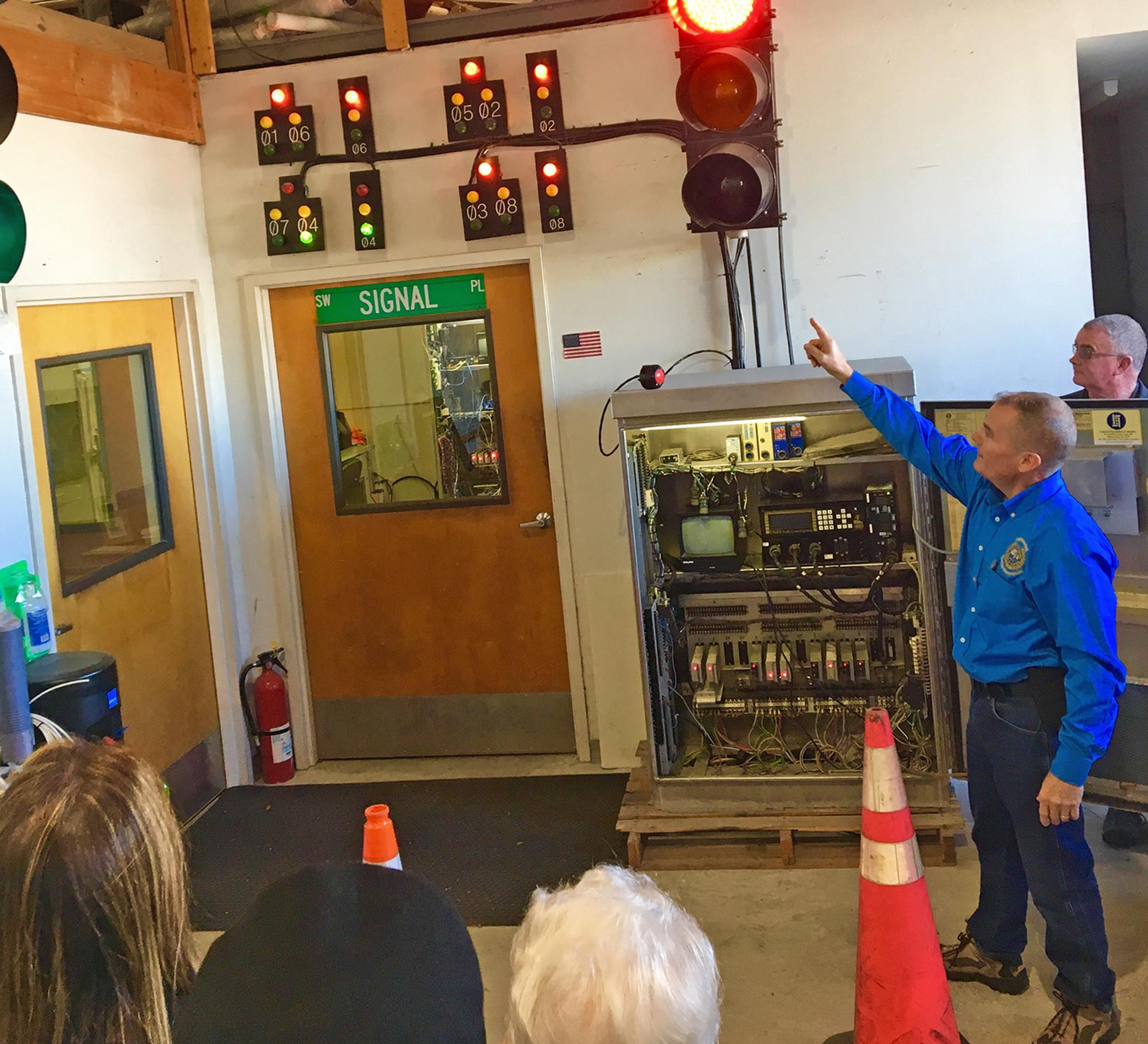 Engineering staff demonstrate traffic signals