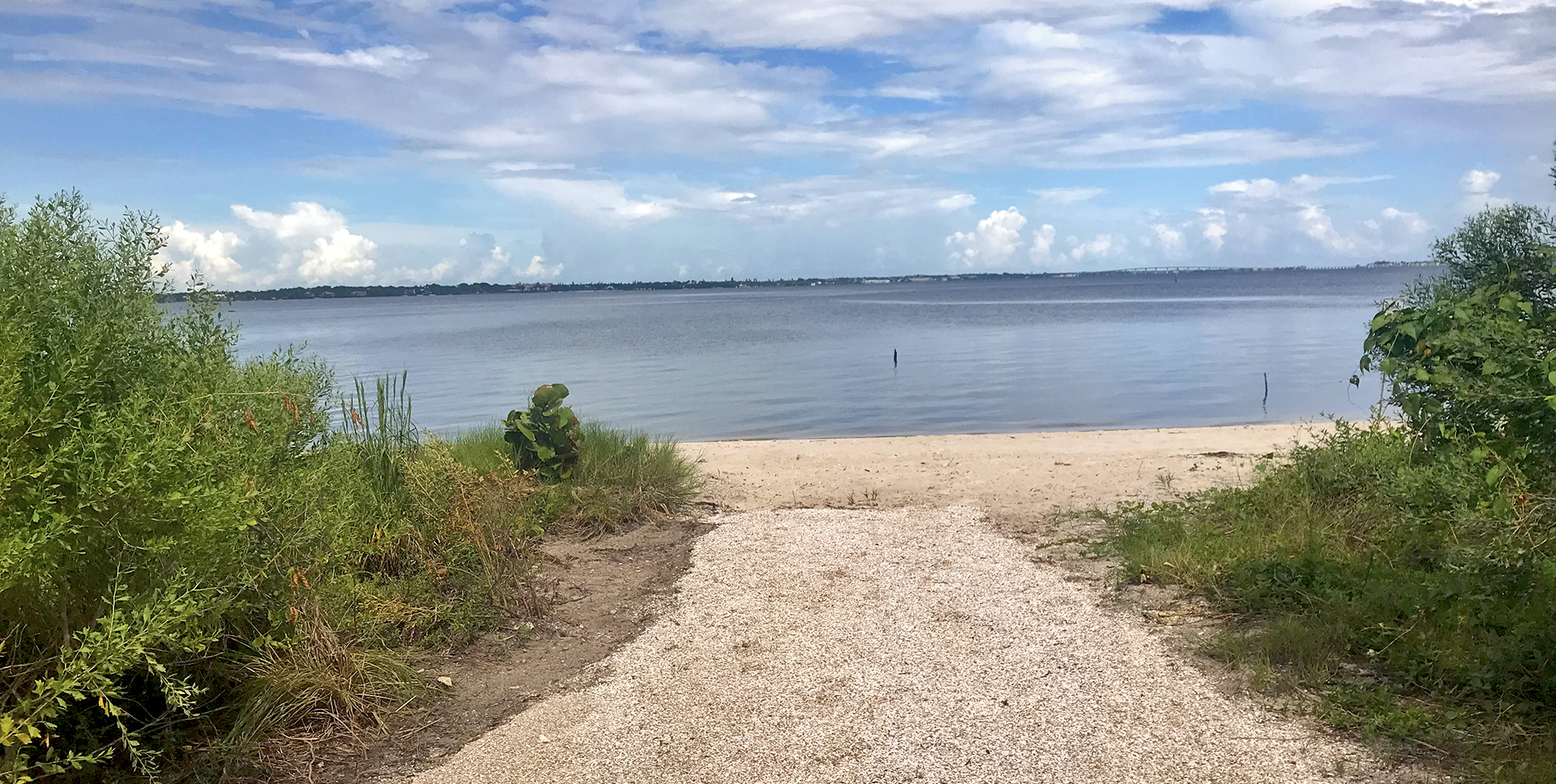 A sandy path leading to the Indian River Lagoon at River cove