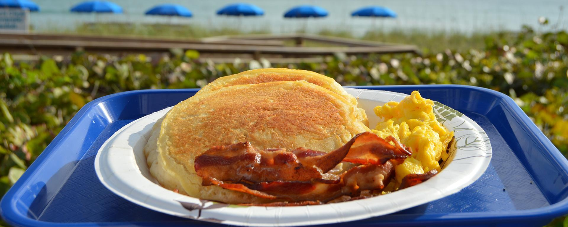 A plate of pancakes, eggs and bacon from Sand Dune Cafe.