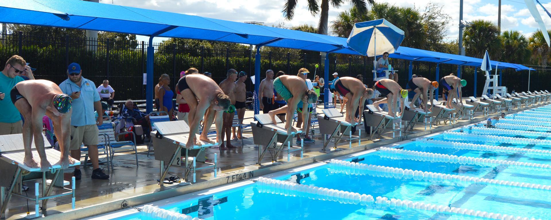 Athletes participate in a swim event during the senior games