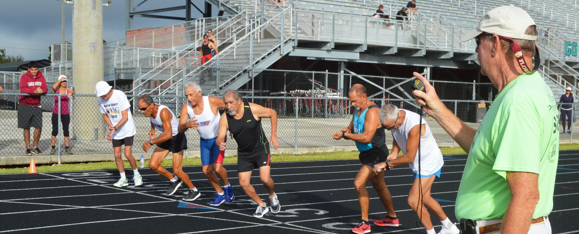 Martin County Senior Games participants running track.