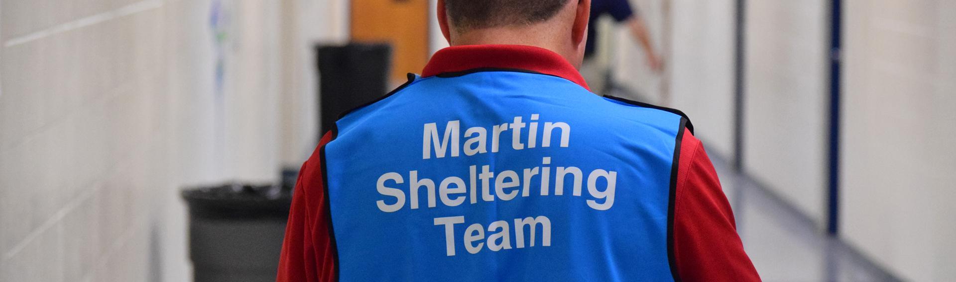 Volunteer wearing a vest that says Martin Shelter Team