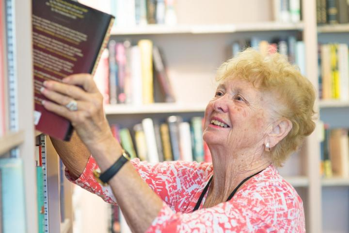 Photo of a library volunteer in Bonnie's Books bookstore at the Blake Library in Stuart