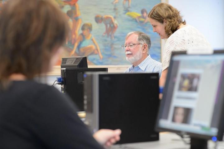 Staff helping people on the computer