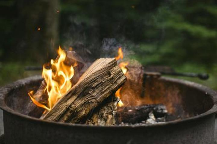 A fire pit with a bonfire burning