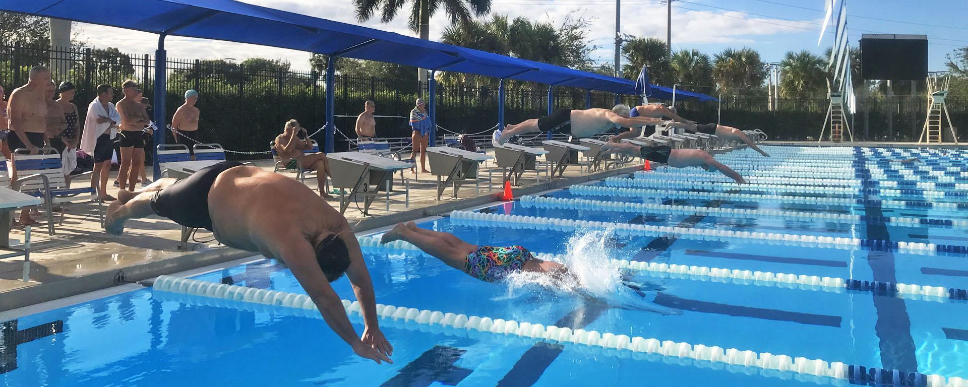 Martin County Senior Games participants diving into the swim races.