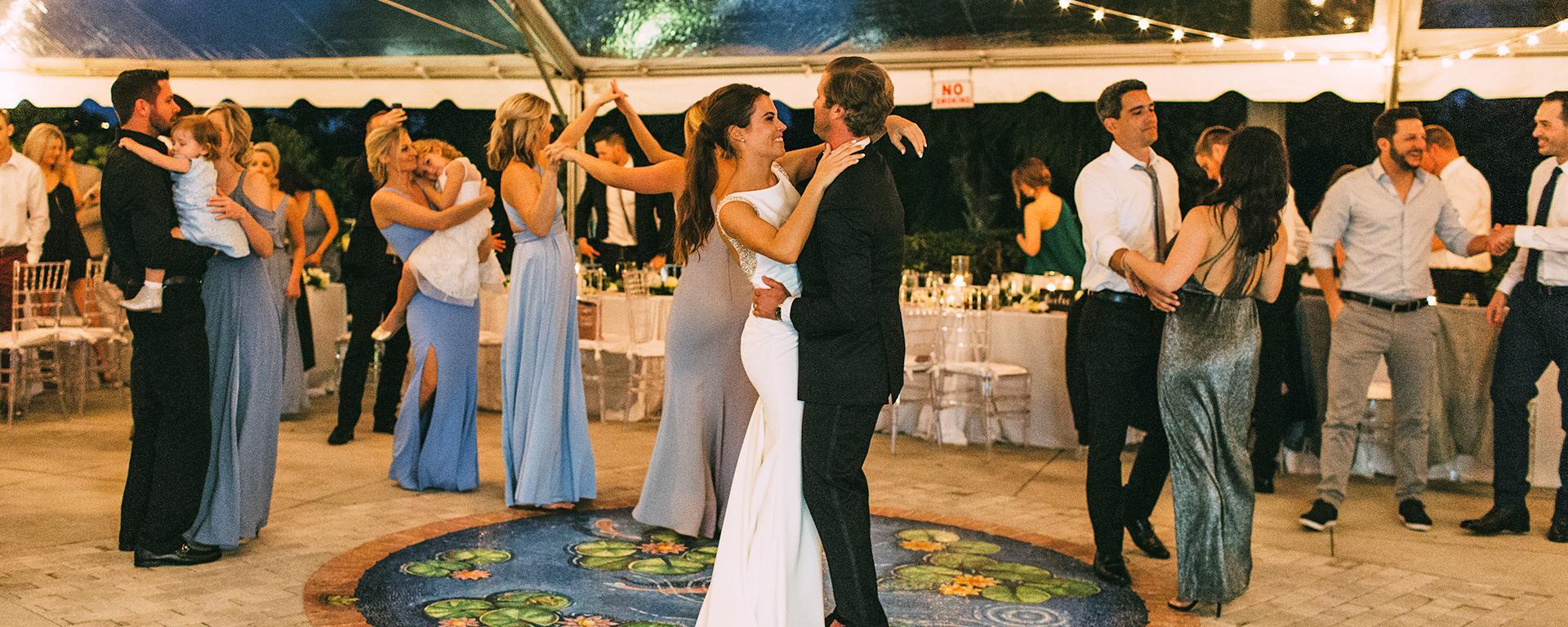 Wedding attendees dancing