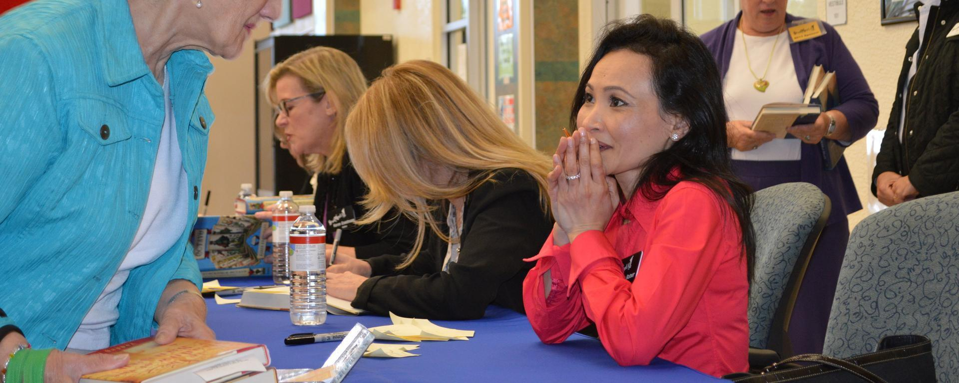 Authors signing books