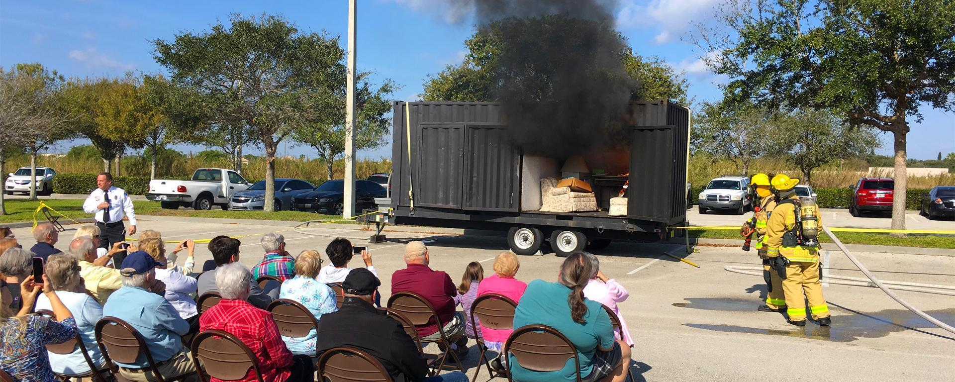 Martin CARES participants watch a fire department demonstration