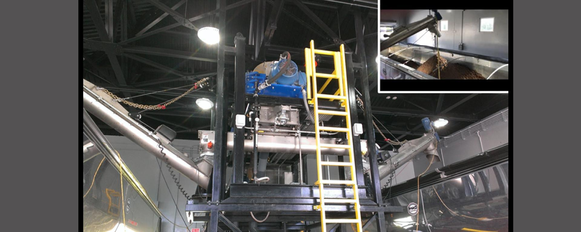 Tropical Farms sewage sludge centrifuge, a high speed, rapid rotation process to separate wastewater solids from liquid.  The end result is approximately 18% - 20% solids product material.