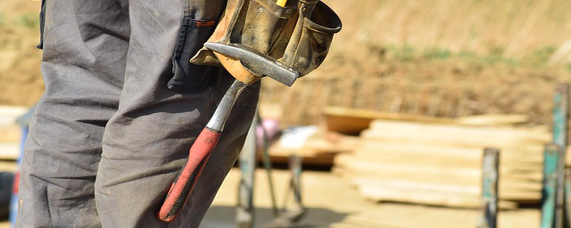 A Contractor Surveys a Site