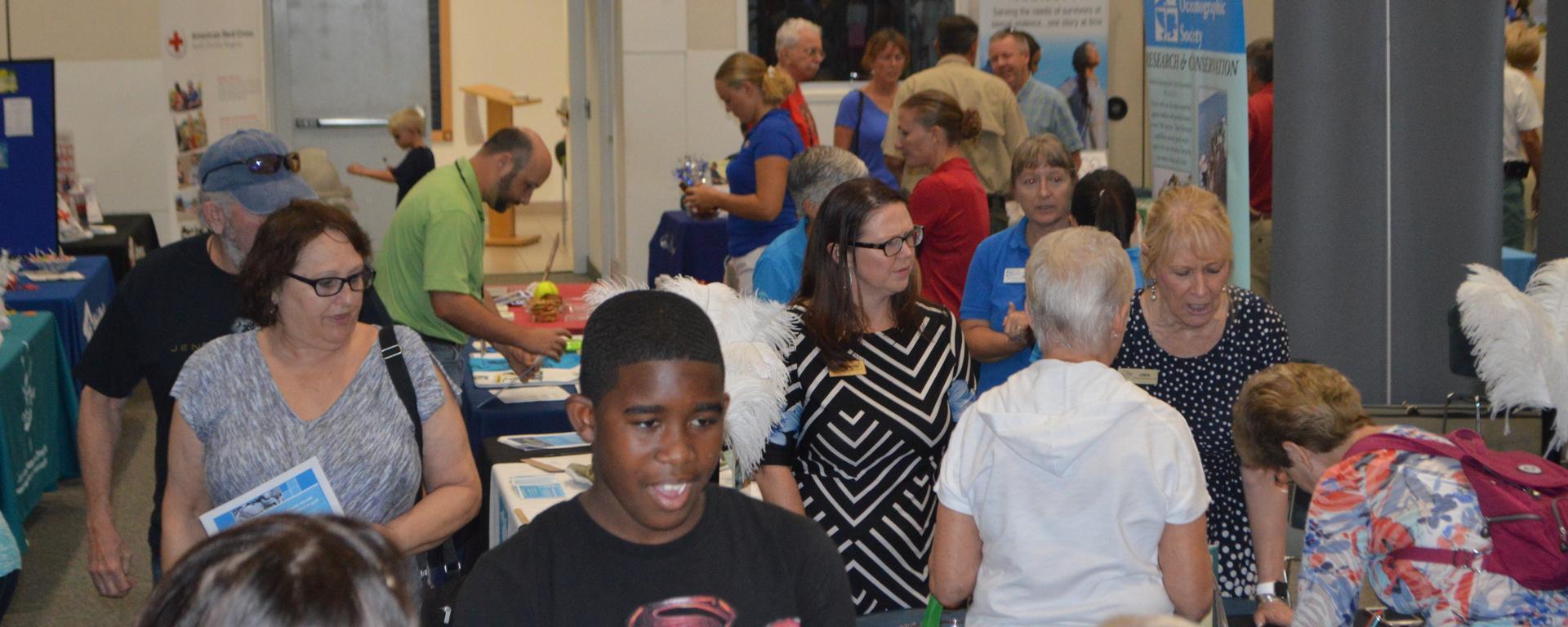 crowd of people at the volunteer fair