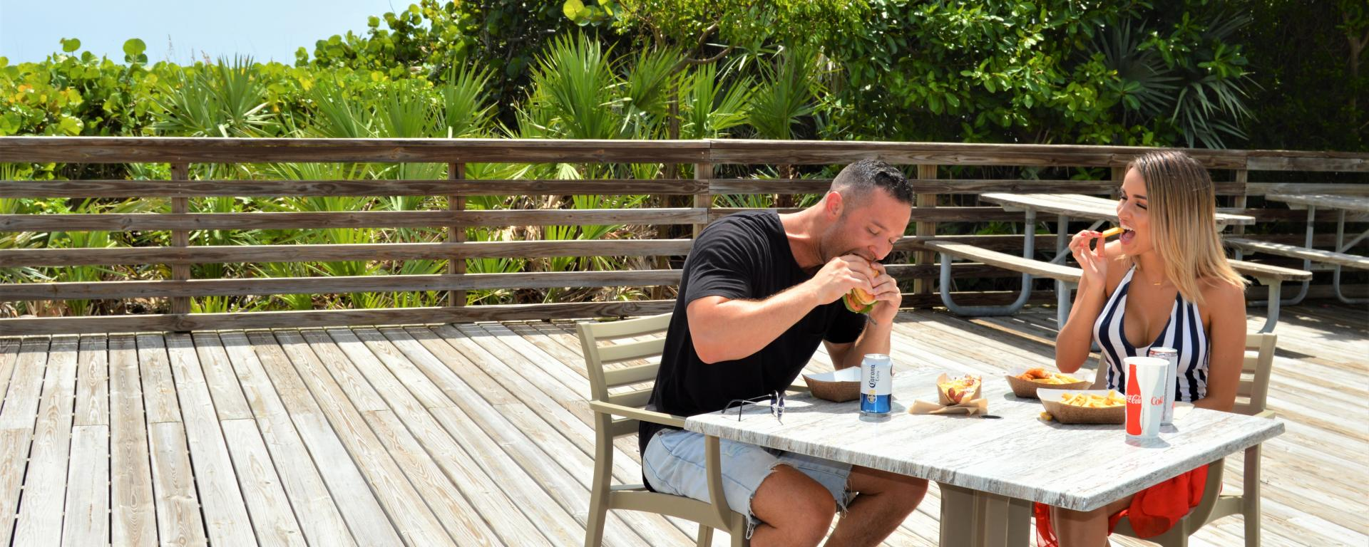 A couple enjoying food on the deck at Sand Dune Cafe.