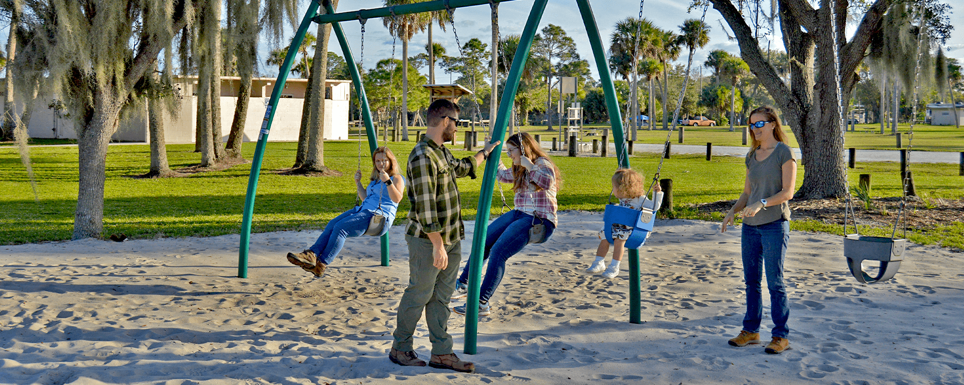 A family enjoying the playground at Phipps Park