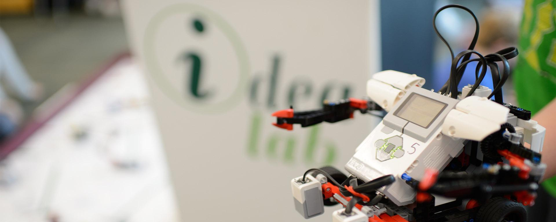 Image of a robot in front of the idea lab podium