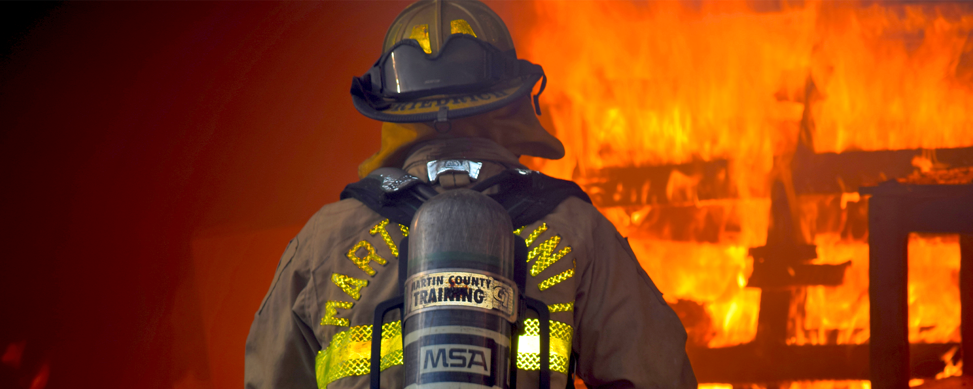 A firefighter working to extinguish a blaze