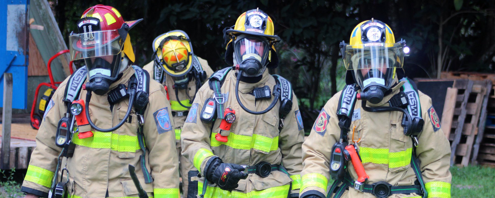 A group of firefighters walking together in protective fire gear