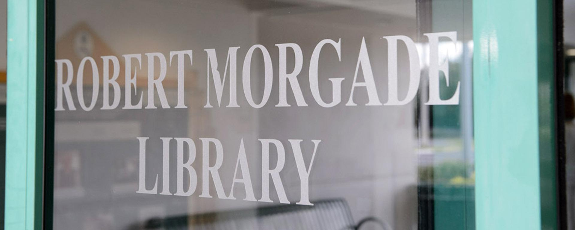 picture of the library's name on a glass door