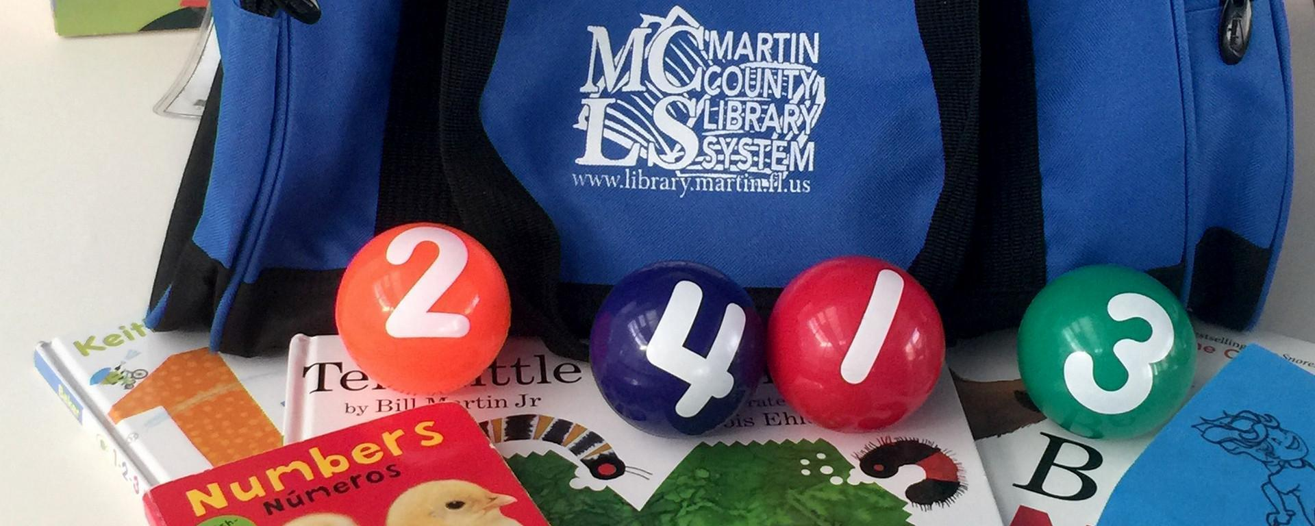 bag with numbered balls and books for a number-themed story time at home