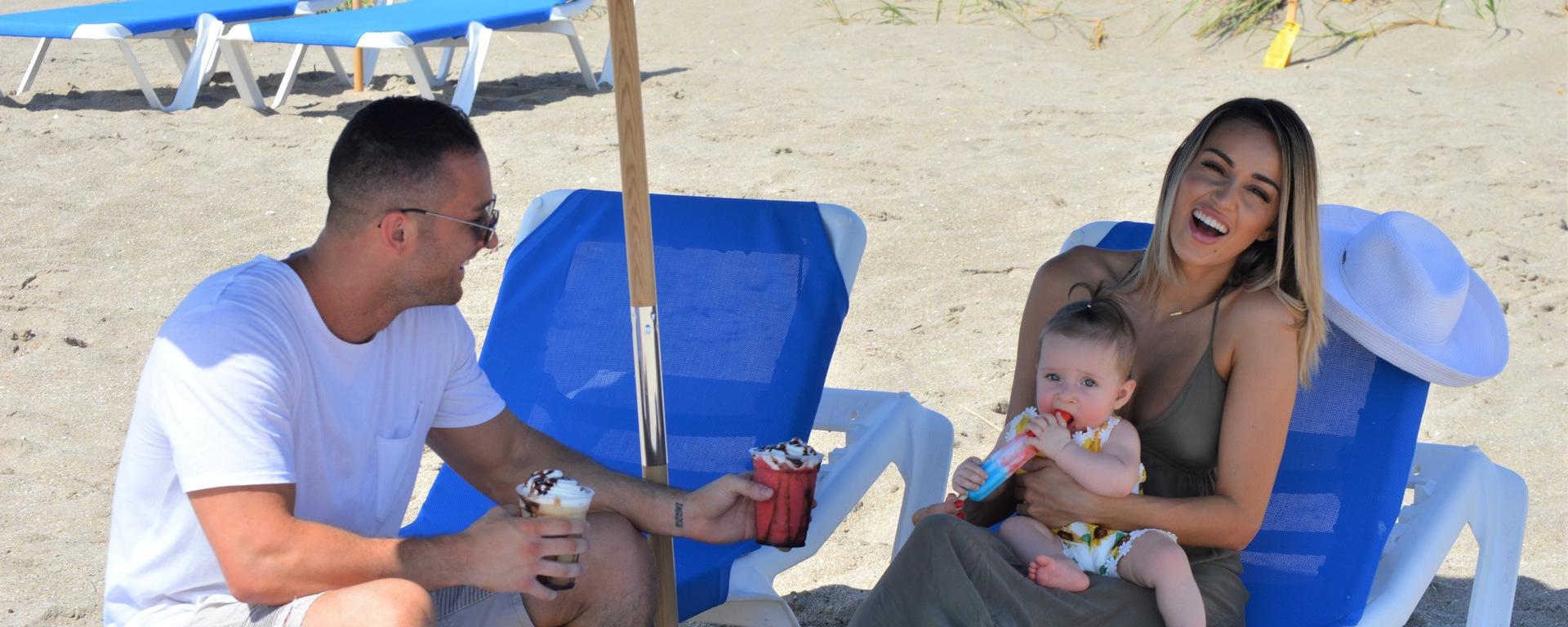 A family enjoying their time at the beach on our rented beach chairs