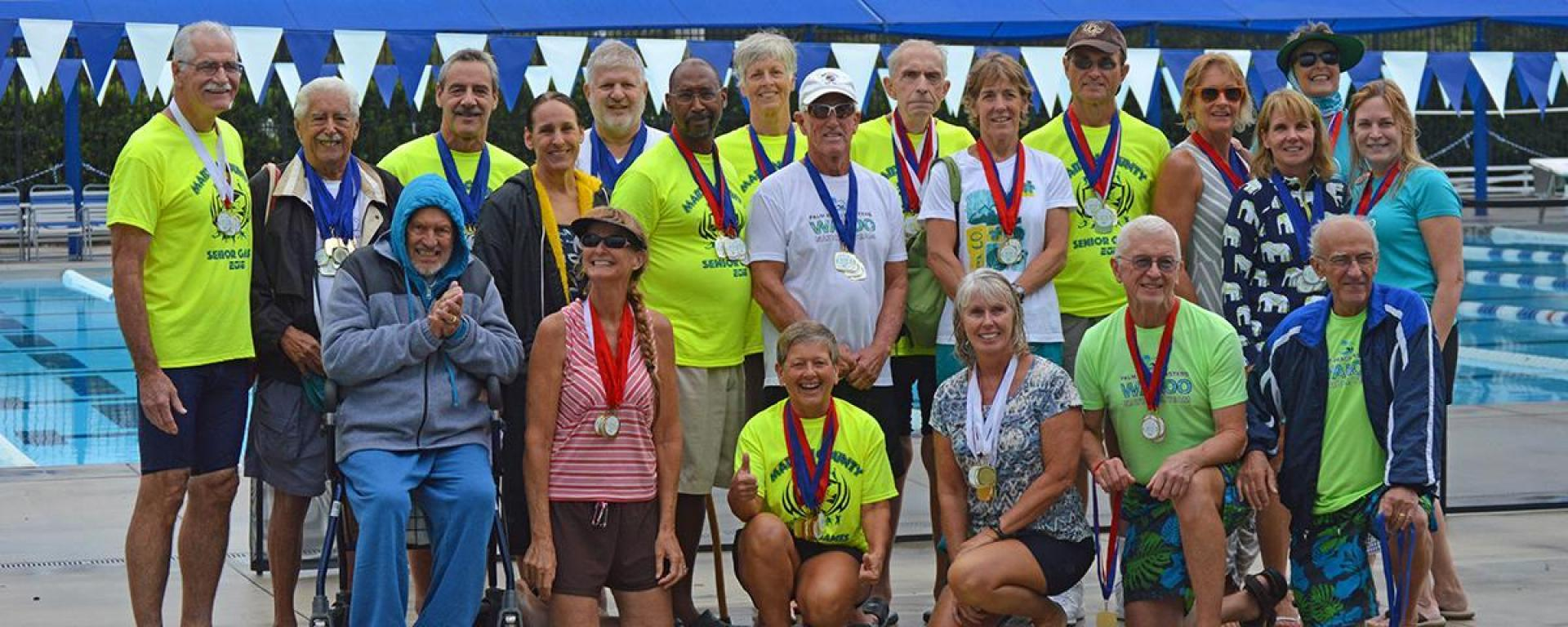 Martin County Senior Games participants with medals.