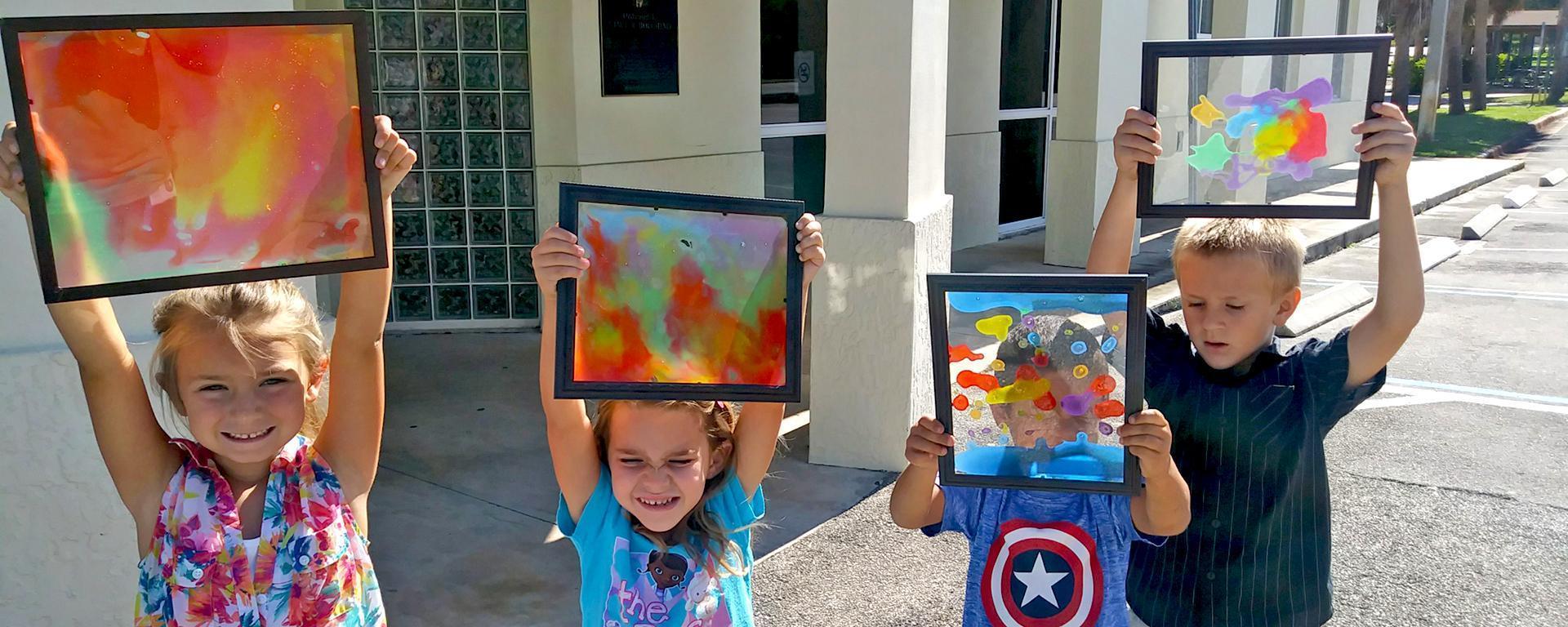 Kid holding artwork