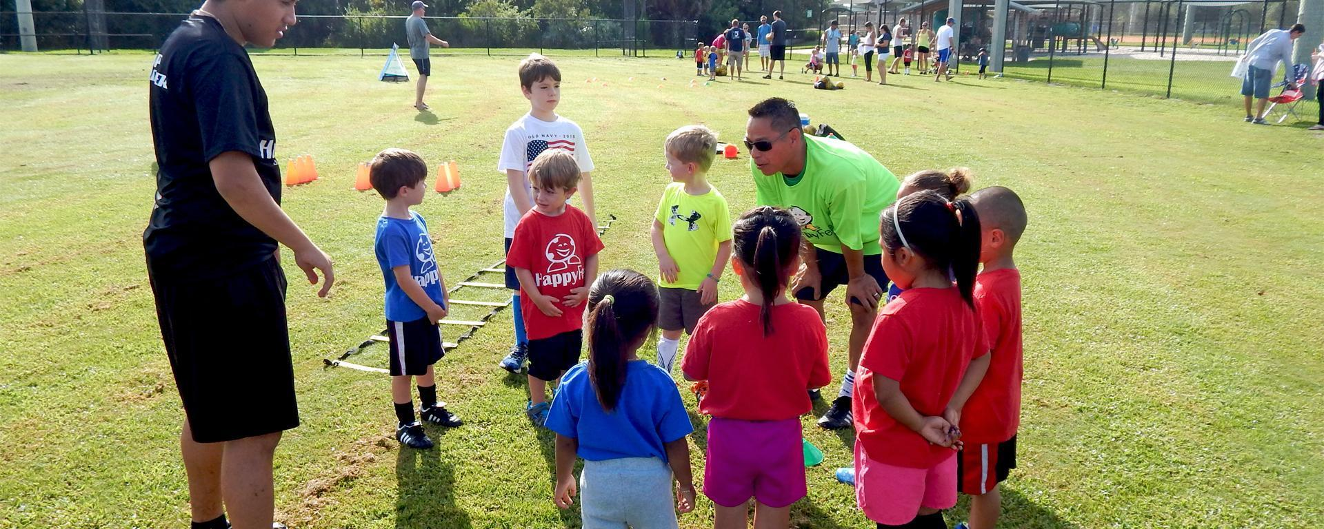 Youth soccer team meeting with their coach.