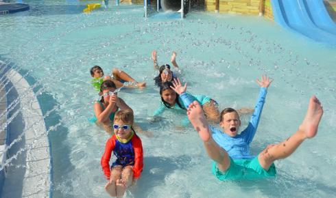 Six smiling children at Sailfish Splash Waterpark