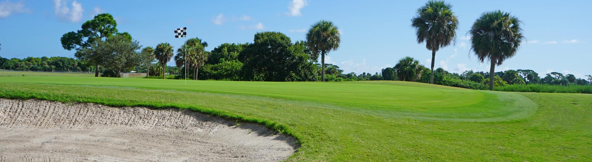 Golf greens of Sailfish Sands Golf Course with bunker