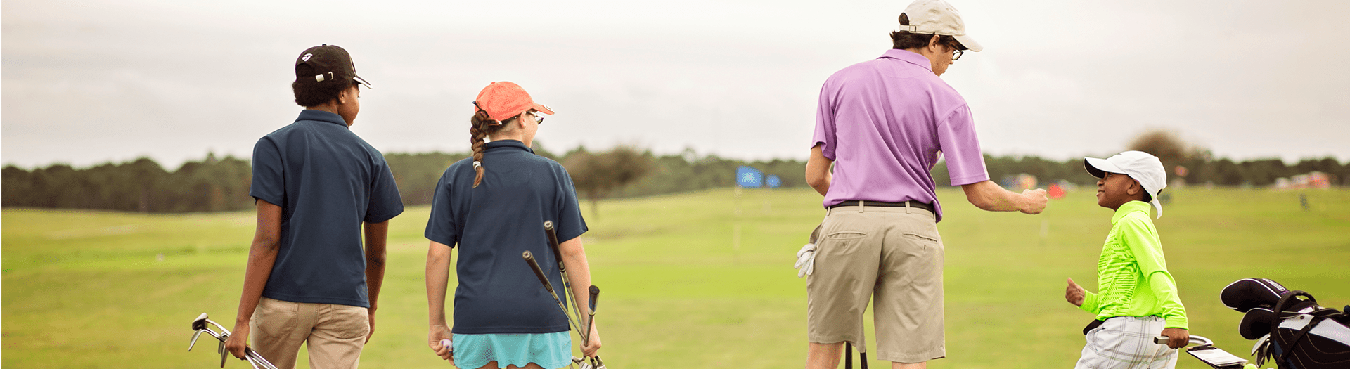 Kids walking onto a golf course