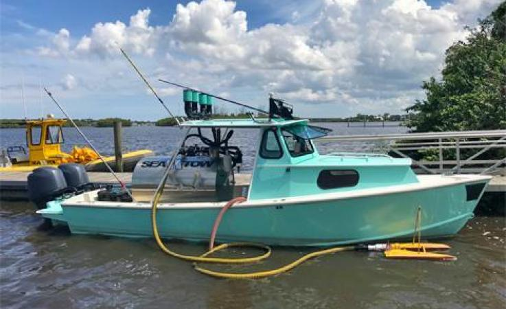 Boat with equipment to remove algae