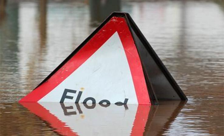 A flood sign under water