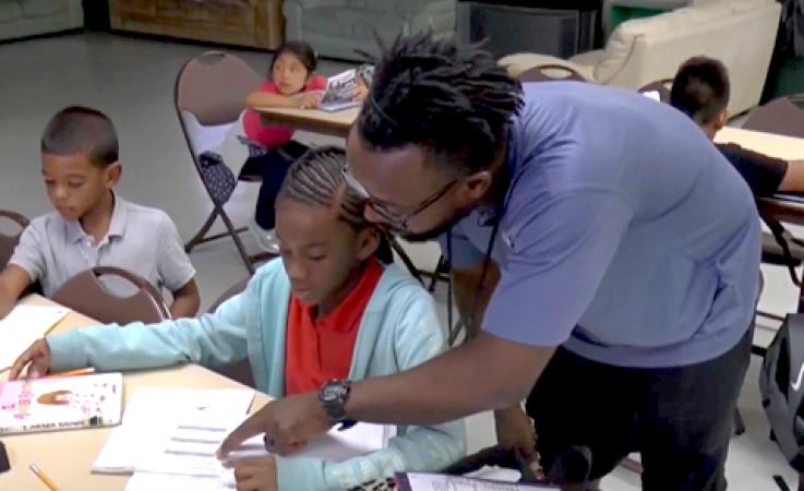A teacher helping a student