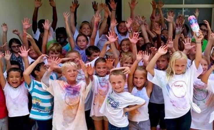 Kids participating in summer camp activities