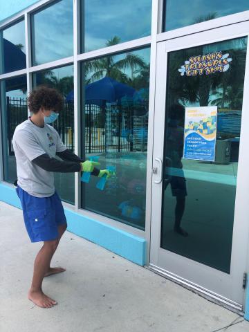 Employee cleaning windows