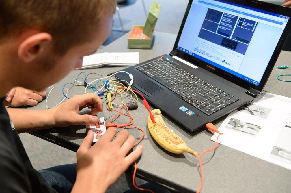 Picture of a teen coding a circuit board at the Blake Library